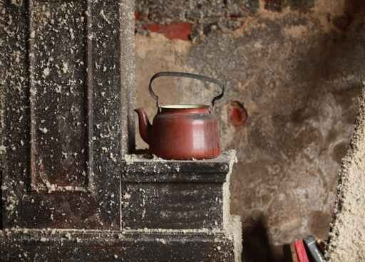 old kettle on the stove an abandoned house